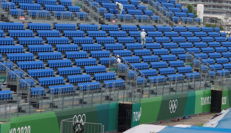 Workers inspect seats at Tokyo2020 Olympic BMX Track in preparation for the Tokyo 2020 Olympic Games in Tokyo