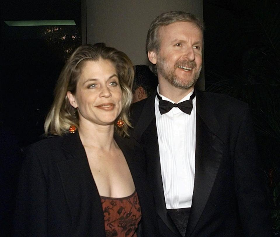 """Director producer of """"Titanic"""" James Cameron, right, and actress Linda Hamilton arrive to the Producers Guild Golden Laurel Awards Tuesday, March 3, 1998, in Beverly Hills, Calif.  Cameron is nominated for the Darryl F. Zanuck Theatrical Motion Picture Producer of the Year Award. (AP Photo/Kevork Djansezian)"""