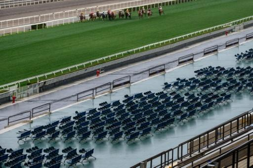 Team Spirit ridden by Tony Piccone heads the field past empty grandstands before going on to win the eighth race at Hong Kong's Sha Tin racecourse on Sunday