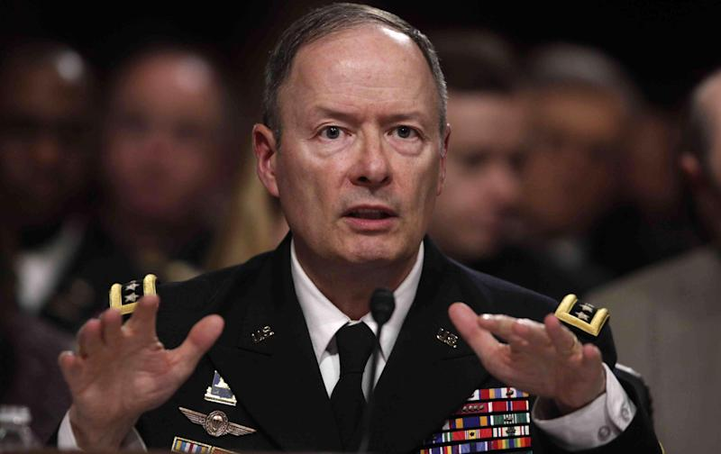 FILE - In this June 12, 2013 file photo, Gen. Keith B. Alexander, commander, U.S. Cyber Command and director, National Security Agency/Chief, Central Security Service testifies on Capitol Hill in Washington.  Alexander will testify during a hearing of the House Intelligence Committee Tuesday, June 18th.   (AP Photo/Charles Dharapak)