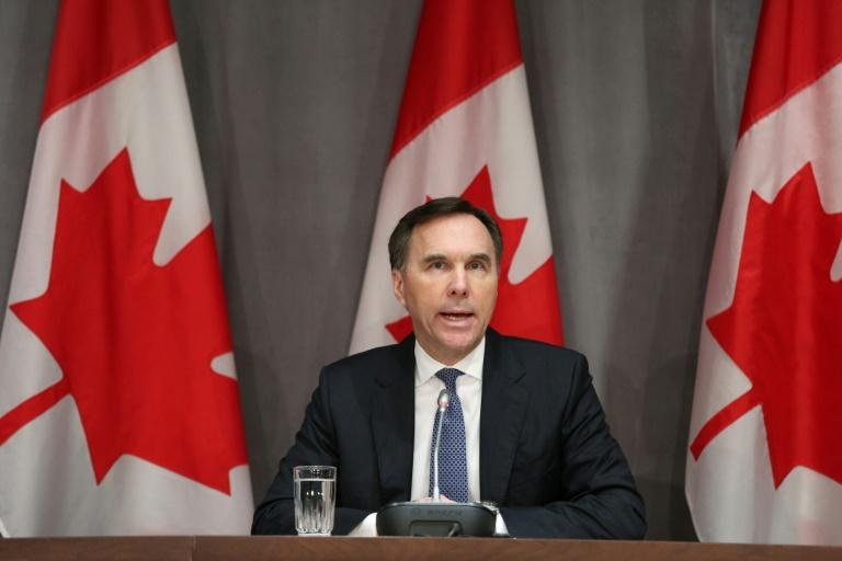 Canada's Finance Minister Bill Morneau speaks during a news conference on Parliament Hill March 18, 2020 in Ottawa, Ontario. Canadian Prime Minister Justin Trudeau announced Can$27 billion in direct aid on March 18, 2020 to help workers and businesses cope with the economic impacts of the coronavirus pandemic.He said tax payments worth an estimated Can$55 billion could be deferred until August