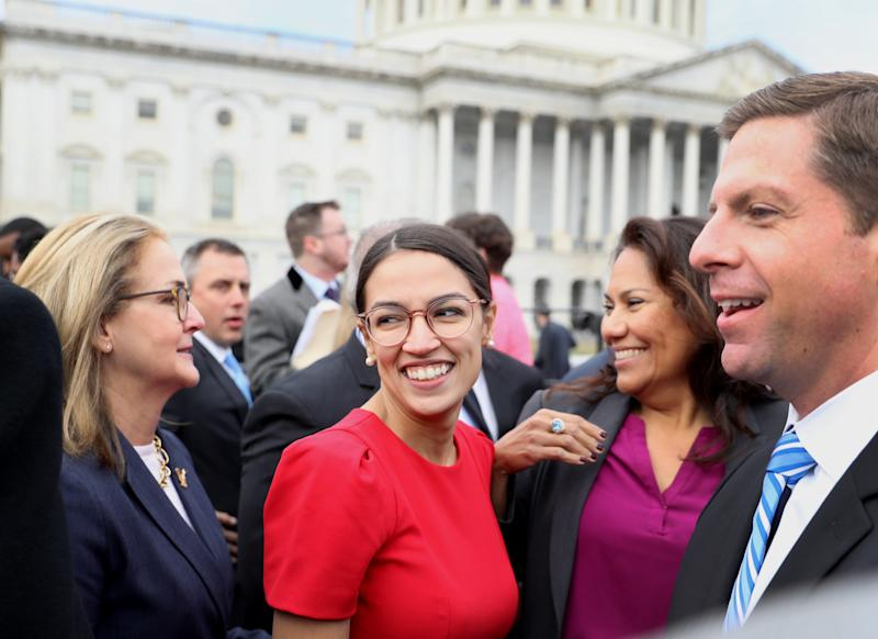 Rep.-elect Alexandria Ocasio-Cortez, a Democrat from New York, smiles after a group photo with the 116th Congress outside the U.S. Capitol on Nov. 14, 2018.  (Bloomberg via Getty Images)