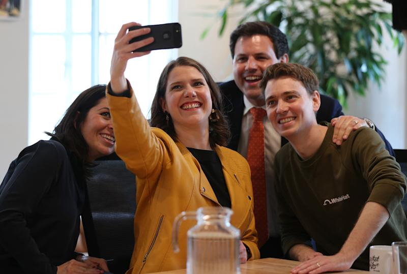 Jo Swinson (centre) takes a selfie with the co-founders of WhiteHat Sophie Adelman and Euan Blair, along with Lib Dem MEP Antony Hook, at WeWork in Marylebone, London, where she launched her campaign to succeed Sir Vince Cable as leader of the Liberal Democrats. (Photo by Yui Mok/PA Images via Getty Images)