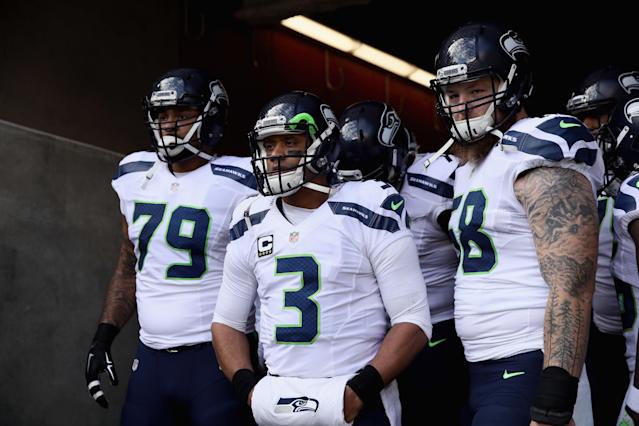 Protecting Russell Wilson has paid dividends for the Seahawks' offensive linemen. (Photo by Ezra Shaw/Getty Images)