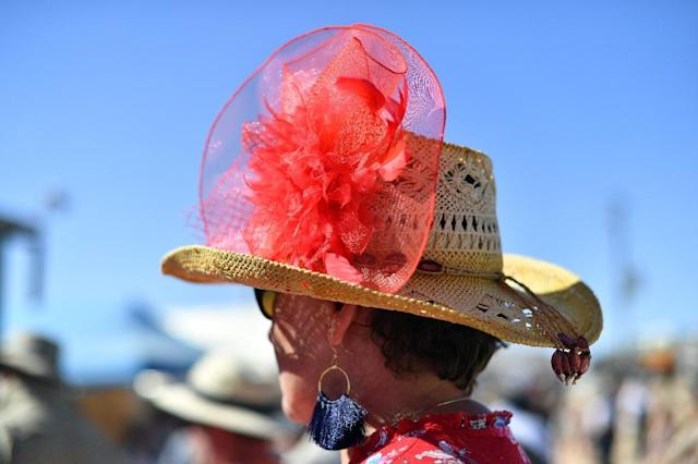 Despite the heat, dust and flies, many racegoers dressed up for the occasion in Birdsville (AFP Photo/Saeed KHAN)