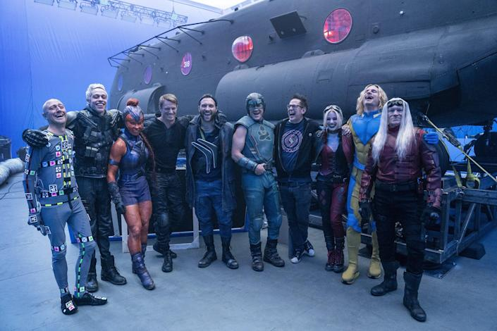 """Some of the very large cast of """"The Suicide Squad"""" on set with director James Gunn."""