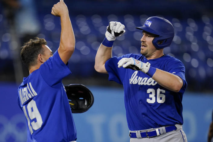 Israel's Ryan Lavarnway (36) celebrate with Danny Valencia after hitting a home run in the sixth inning of a baseball game against South Korea at the 2020 Summer Olympics, Thursday, July 29, 2021, in Yokohama, Japan. (AP Photo/Sue Ogrocki)