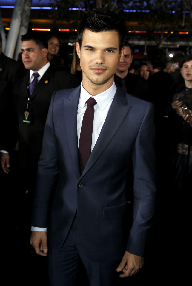 "Taylor Lautner arrives to the world premiere of ""The Twilight Saga: Breaking Dawn - Part 1"" on Monday, Nov. 14, 2011, in Los Angeles. (AP Photo/Matt Sayles)"