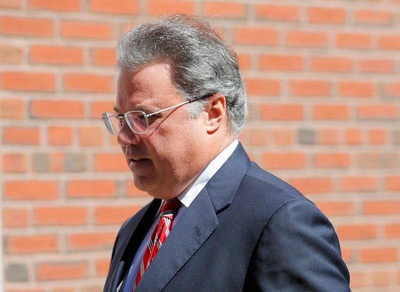 FILE PHOTO:  Manuel Henriquez, founder and chairman and CEO of Hercules Technology Growth Capital, facing charges in a nationwide college admissions cheating scheme, enters federal court in Boston