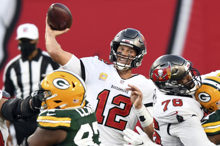 Tom Brady and the Buccaneers are underdogs in the NFC championship game. (AP Photo/Jason Behnken)