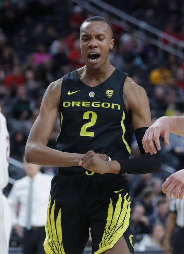 Oregon's Louis King celebrates after scoring against Utah during the second half of an NCAA college basketball game in the quarterfinals of the Pac-12 men's tournament Thursday, March 14, 2019, in Las Vegas. (AP Photo/John Locher)