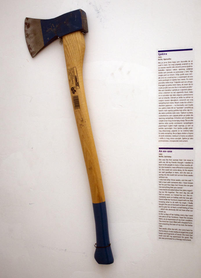 In this photo taken Friday, Feb. 10, 2012, an axe is displayed at the Museum of Broken Relationships in Zagreb, Croatia. The exhibits, collected from all over the world, are random and varied, ranging from fake breasts to a cast from a broken leg. Each item is accompanied by a summary of dates and locations of the relationships, and notes written by their anonymous donors. (AP Photo/Darko Bandic)