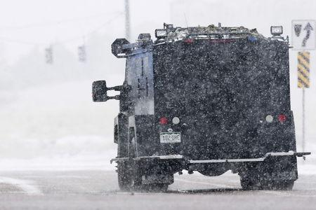 An armored vehicle drives down a road leading to a Planned Parenthood center after reports of an active shooter in Colorado Springs, November 27, 2015. REUTERS/Isaiah J. Downing