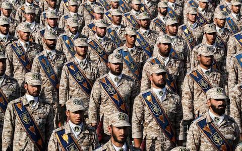 """<span>Members of Iran's Islamic Revolutionary Guard Corps (IRGC) standing in formation during the annual """"Sacred Defence Week""""</span> <span>Credit: AFP </span>"""