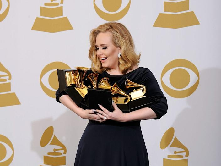 Adele with her 2011 Grammy-award haul.