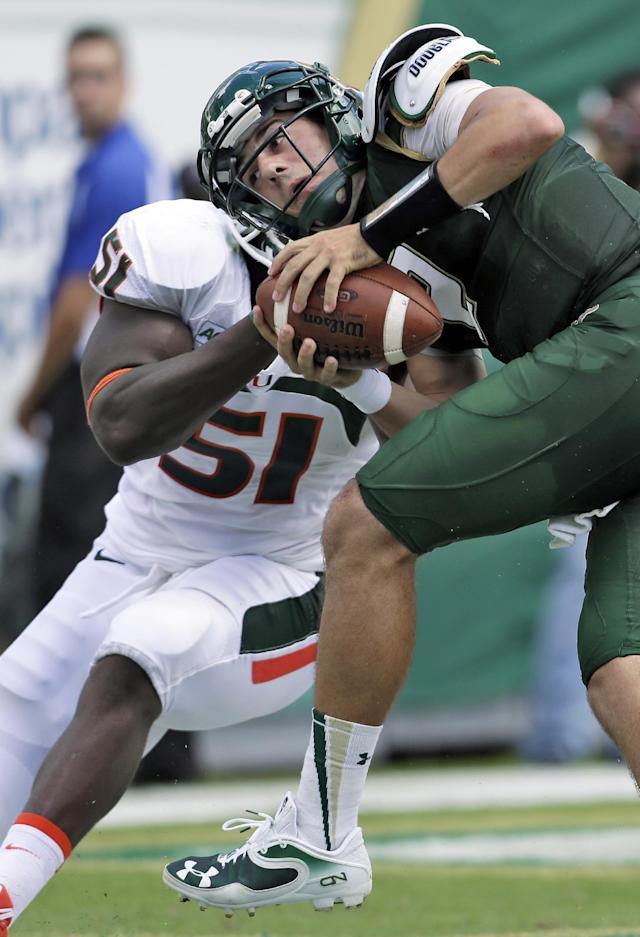 South Florida quarterback Steven Bench (2) is sacked in the end zone by Miami defensive lineman Shayon Green (51) during the second quarter of an NCAA college football game Saturday, Sept. 28, 2013, in Tampa, Fla. Bench fumbled on the play and Miami recovered for the score. (AP Photo/Chris O'Meara)