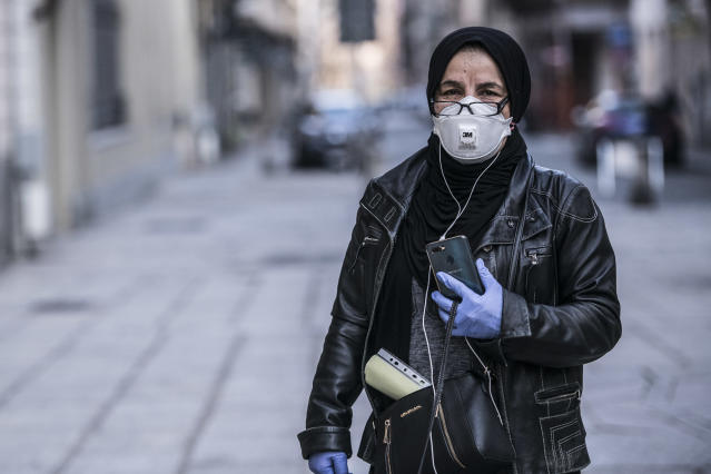 A woman wearing a mask and gloves in Turin. Italy has had more than 35,700 confirmed cases since the coronavirus outbreak was identified. (Getty Images)