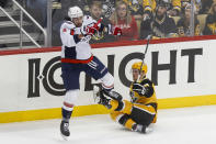 Washington Capitals' Brenden Dillon, left, checks Pittsburgh Penguins' Sam Lafferty during the first period of an NHL hockey game, Saturday, March 7, 2020, in Pittsburgh. Dillon was penalized for interference on the play. (AP Photo/Keith Srakocic)