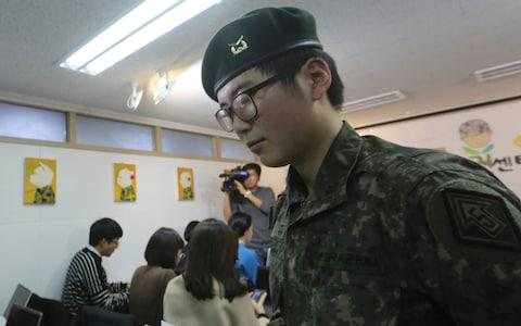 Sergeant Byun Hui-su held a press conference to highlight her plight  - Credit: AP Photo/Ahn Young-joon
