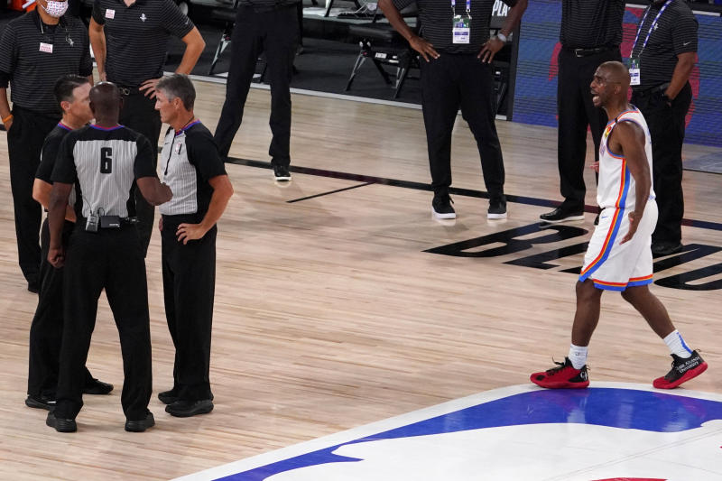 Chris Paul walks up to referees on the court.