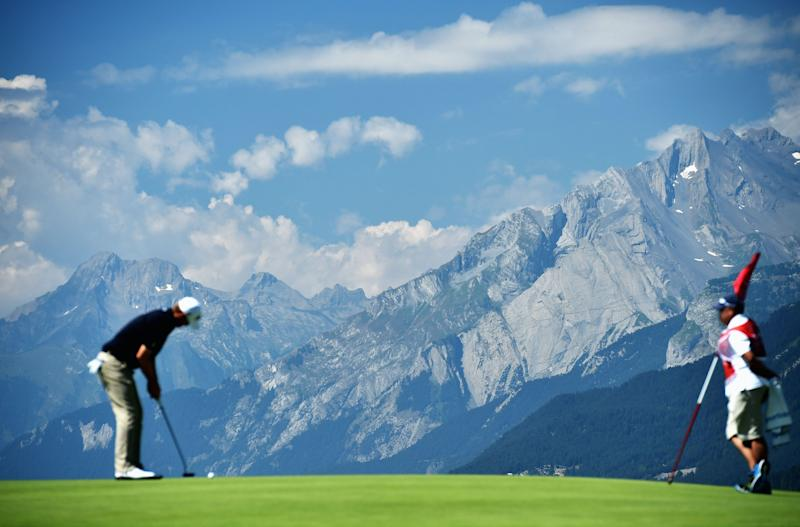 A player putts with the Alps in the background during the second round of the Omega European Masters at Crans-sur-Sierre Golf Club on July 24, 2015 in Crans-Montana, Switzerland. (Photo by Stuart Franklin/Getty Images)