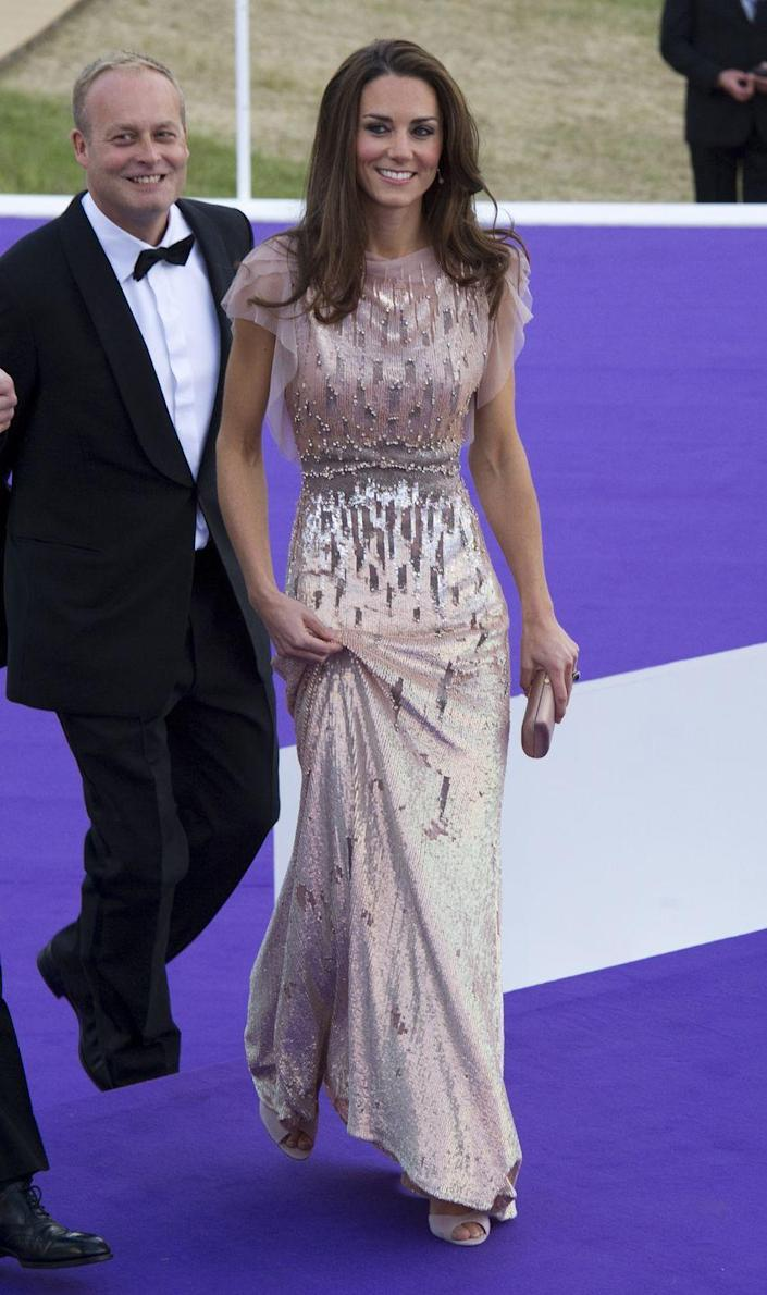 <p>In one of her first appearances after her royal wedding in April 2011, Duchess Kate stunned in a blush Jenny Packham gown with elaborate detailing on the front. </p>
