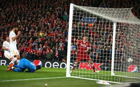 Firmino turns in Liverpool's fourth - Credit: Dave Thompson/AP