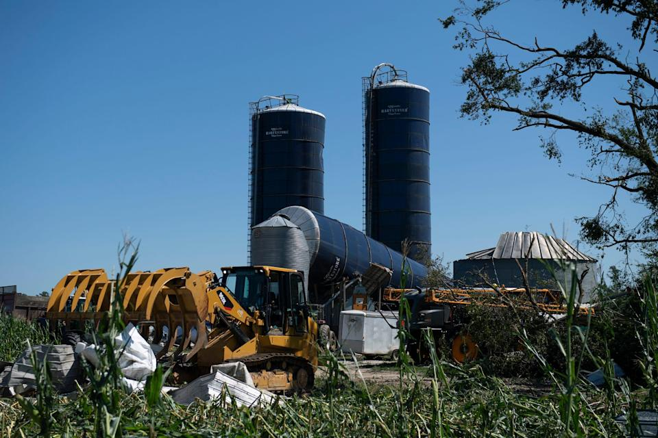 A grain silo is down and cornfields are flattened at Wellacrest Farm in Mullica Hill, N.J., on Thursday, after a tornado.