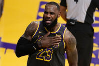 Los Angeles Lakers forward LeBron James reacts after scoring against the Indiana Pacers during the first half of an NBA basketball game Friday, March 12, 2021, in Los Angeles. (AP Photo/Marcio Jose Sanchez)