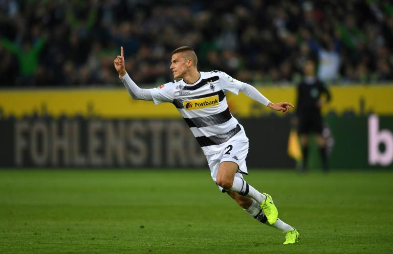 Moenchengladbach's Slovak midfielder Laszlo Benes celebrates scoring with his team-mates during the German first division Bundesliga football match of Borussia Moenchengladbach v Hertha Berlin in Moenchengladbach, western Germany, on April 5, 2017