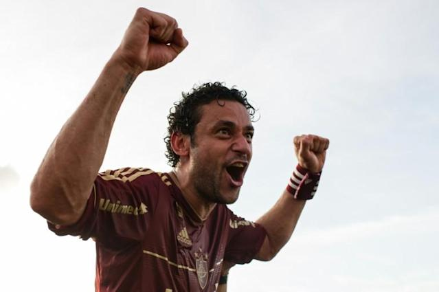 Fred celebrates winning the Brazilian title with Fluminense in 2012 (AFP Photo/YASUYOSHI CHIBA)