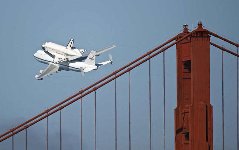 The space shuttle Endeavour passes over the Golden Gate Bridge in San Francisco, Friday, Sept. 21, 2012. Endeavour is making a final trek across the country to the California Science Center in Los Angeles, where it will be permanently displayed. (AP Photo/Michael Kass)