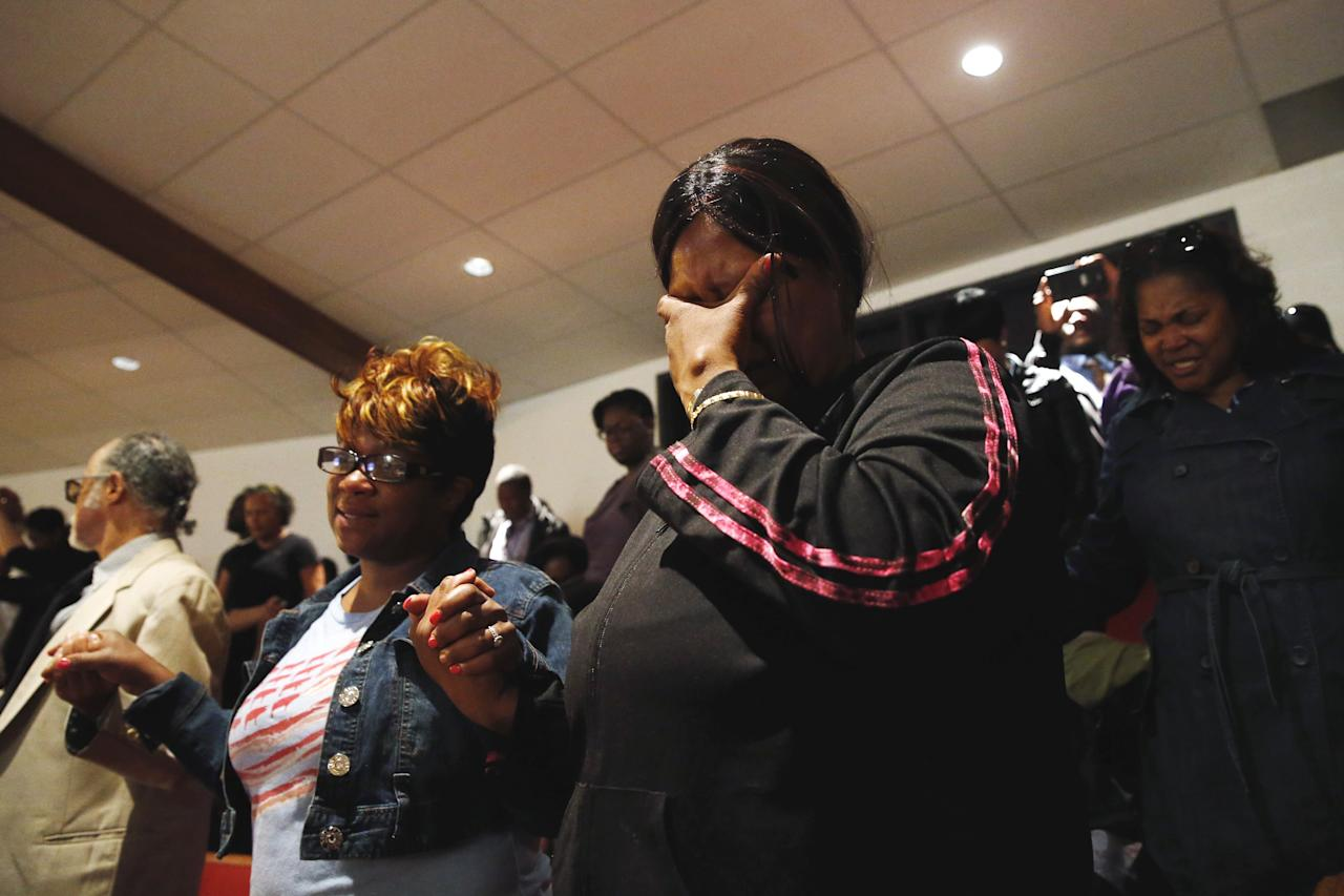 Mourners react during funeral services for 25-year old Freddie Gray, a Baltimore black man who died in police custody, at New Shiloh Baptist Church in Baltimore, Maryland April 27, 2015. Gray's death has led to protests in the latest outcry over U.S. law enforcement's treatment of minorities. Police say he died of a neck injury on April 19 after being arrested on April 12. REUTERS/Shannon Stapleton