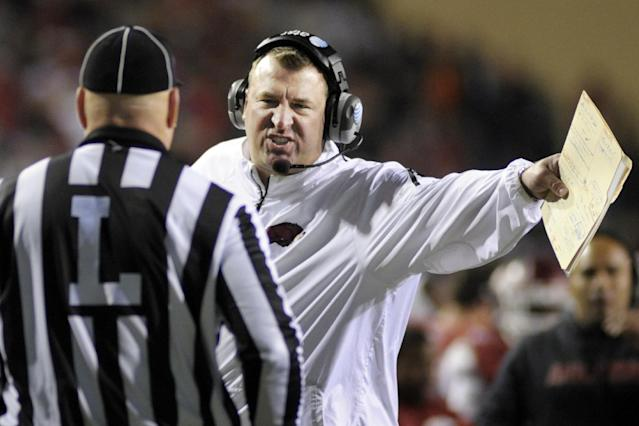 Arkansas coach Bret Bielema talks to an official during the second half of an NCAA college football game against the Auburn, in Fayetteville, Ark., Saturday, Nov. 2, 2013. Auburn won 35-17. (AP Photo/Beth Hall)