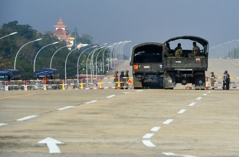 Soldiers stand guard along a blockaded road near Myanmar's parliament in the capital Naypyidaw
