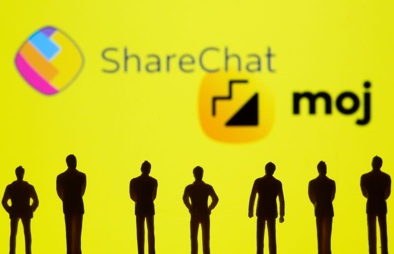 Small toy figures are seen in front of displayed ShareChat and Moj logo in this illustration taken