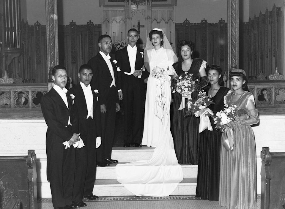 <p>Most brides shied away from having their bridesmaids wearing white by the 1940s. Instead, high-waisted gowns with full, structured shoulders took over.</p>