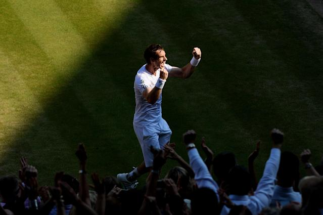 LONDON, ENGLAND - JULY 07: Andy Murray of Great Britain celebrates Championship point during the Gentlemen's Singles Final match against Novak Djokovic of Serbia on day thirteen of the Wimbledon Lawn Tennis Championships at the All England Lawn Tennis and Croquet Club on July 7, 2013 in London, England. (Photo by Mike Hewitt/Getty Images)