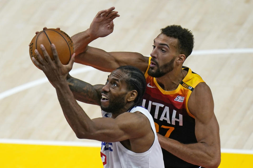 Utah Jazz center Rudy Gobert, rear, defends against Los Angeles Clippers forward Kawhi Leonard.left, during the second half of Game 1 of a second-round NBA basketball playoff series Tuesday, June 8, 2021, in Salt Lake City. (AP Photo/Rick Bowmer)