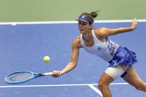 Tsvetana Pironkova, of Bulgaria, returns a shot to Serena Williams, of the United States, during the quarterfinals of the US Open tennis championships, Wednesday, Sept. 9, 2020, in New York. (AP Photo/Seth Wenig)