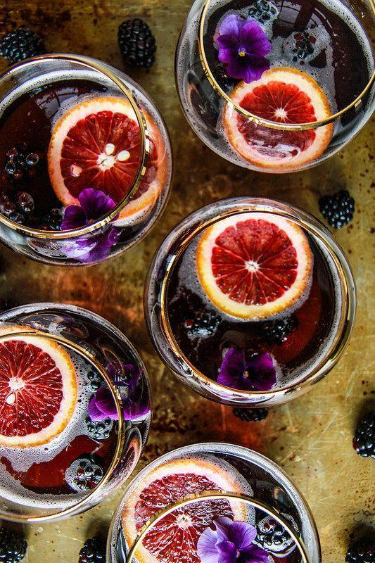 "<p>Mix blackberry soda, blood orange slices, and rum together for this elegant Halloween cocktail.</p><p><em><a href=""http://heatherchristo.com/2016/02/17/blood-orange-blackberry-rum-punch/"" rel=""nofollow noopener"" target=""_blank"" data-ylk=""slk:Get the recipe from Heather Christo »"" class=""link rapid-noclick-resp"">Get the recipe from Heather Christo »</a></em></p>"