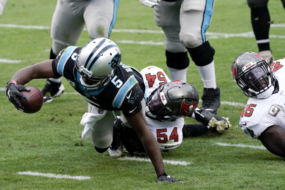 Carolina Panthers quarterback Teddy Bridgewater (5) lunges into the end zone for a touchdown against the Tampa Bay Buccaneers during the second half of an NFL football game, Sunday, Nov. 15, 2020, in Charlotte , N.C. (AP Photo/Gerry Broome)