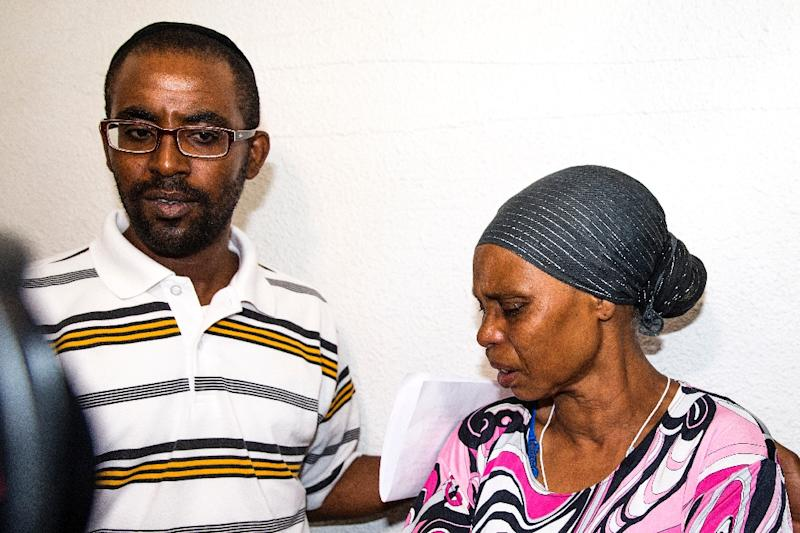 The brother and mother of Avraham Mengistu -- an Israeli of Ethiopian descent who is reportedly being held captive in the Gaza Strip -- appeal for his release during a press conference in the southern Israeli city of Ashkelon, on July 9, 2015 (AFP Photo/Jack Guez)