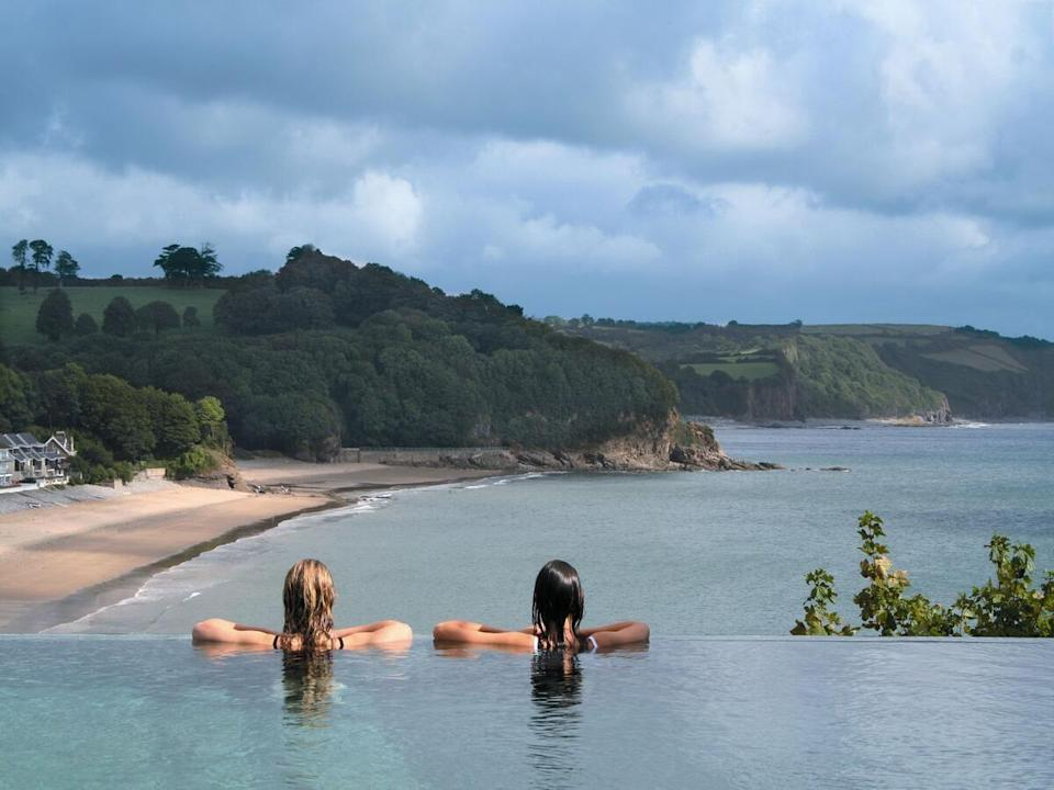 """<p>Perched on a clifftop overlooking the beautiful sands at Saundersfoot in the Pembrokeshire Coast National Park, <a href=""""https://go.redirectingat.com?id=127X1599956&url=https%3A%2F%2Fwww.booking.com%2Fhotel%2Fgb%2Fstbrideshotel.en-gb.html%3Faid%3D2070935%26label%3Dcoastal-retreats&sref=https%3A%2F%2Fwww.countryliving.com%2Fuk%2Ftravel-ideas%2Fstaycation-uk%2Fg34736870%2Fcoastal-retreats%2F"""" rel=""""nofollow noopener"""" target=""""_blank"""" data-ylk=""""slk:St Brides Spa Hotel"""" class=""""link rapid-noclick-resp"""">St Brides Spa Hotel</a> is an oasis of calm.</p><p>The Welsh coastal retreat offers dramatic seascapes, scenic walks, and plush pampering at the clifftop spa; there's even a stunning infinity pool with epic views over the beach and ocean below. The Cliff Restaurant also has magnificent views and a locally-sourced menu to match.</p><p><a class=""""link rapid-noclick-resp"""" href=""""https://go.redirectingat.com?id=127X1599956&url=https%3A%2F%2Fwww.booking.com%2Fhotel%2Fgb%2Fstbrideshotel.en-gb.html%3Faid%3D2070935%26label%3Dcoastal-retreats&sref=https%3A%2F%2Fwww.countryliving.com%2Fuk%2Ftravel-ideas%2Fstaycation-uk%2Fg34736870%2Fcoastal-retreats%2F"""" rel=""""nofollow noopener"""" target=""""_blank"""" data-ylk=""""slk:CHECK AVAILABILITY"""">CHECK AVAILABILITY</a></p>"""