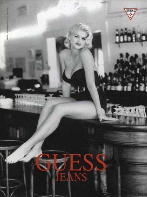Anna Nicole sits on a bar top in Guess ad