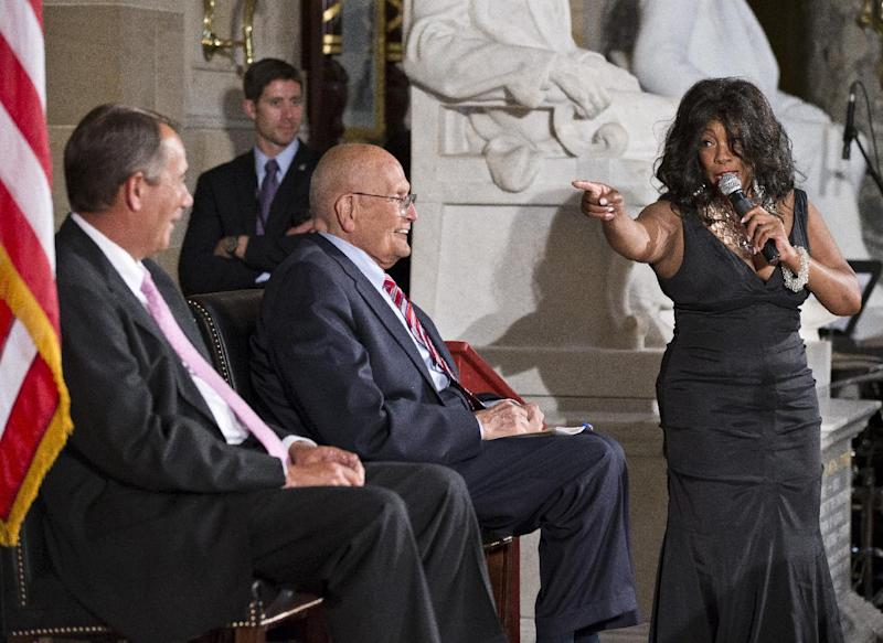 Mary Wilson of the 1960s group The Supremes, sings to Rep. John Dingell, D-Mich., center, who recently became the longest-serving member of Congress, as he is celebrated on Capitol Hill in Washington, Thursday, June 13, 2013. Speaker of the House John Boehner, R-Ohio, watches at left. Dingell, now 86, says he has no plans to retire as the representative of Michigan's 12th District that takes in Dearborn and Ypsilanti. (AP Photo/J. Scott Applewhite)
