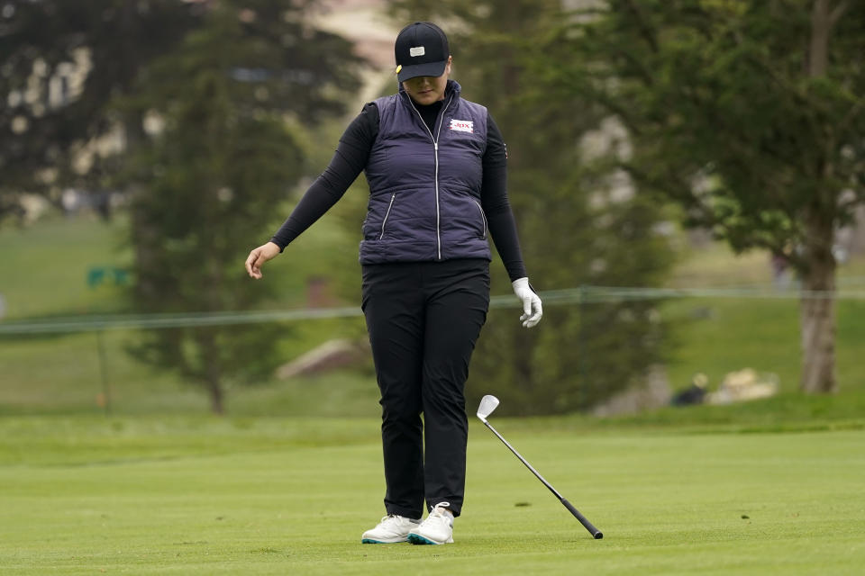 Angel Yin drops her club after her shot on the 12th fairway during the second round of the U.S. Women's Open golf tournament at The Olympic Club, Friday, June 4, 2021, in San Francisco. (AP Photo/Jeff Chiu)
