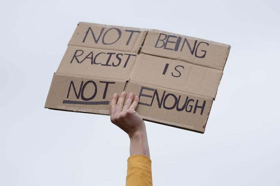 A woman holds up a placard as people demonstrate during a protest in Middlesbrough. (Ian Forsyth/Getty Images)