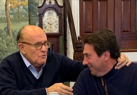 U.S. President Donald Trump's lead attorneys Jay Sekulow and Rudy Giuliani react after Attorney General William Barr sent lawmakers a summary of the key findings in Special Counsel Robert Mueller's Russia investigation, at an office in Washington, U.S., March 24, 2019. Picture taken March 24, 2019.  Courtesy of Peter Halmagyi/Handout via REUTERS