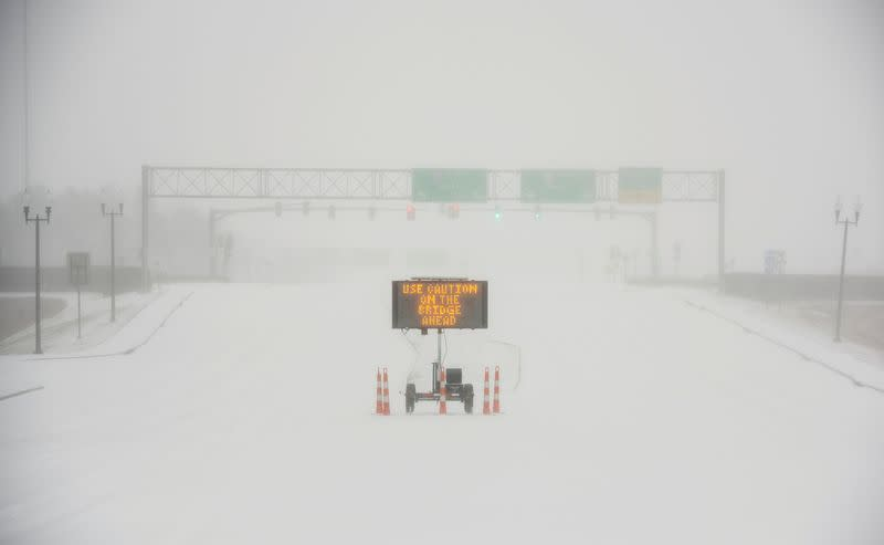 A sign warns motorists after a sudden heavy bout of snow and frozen rain on MS Highway 463 in Madison
